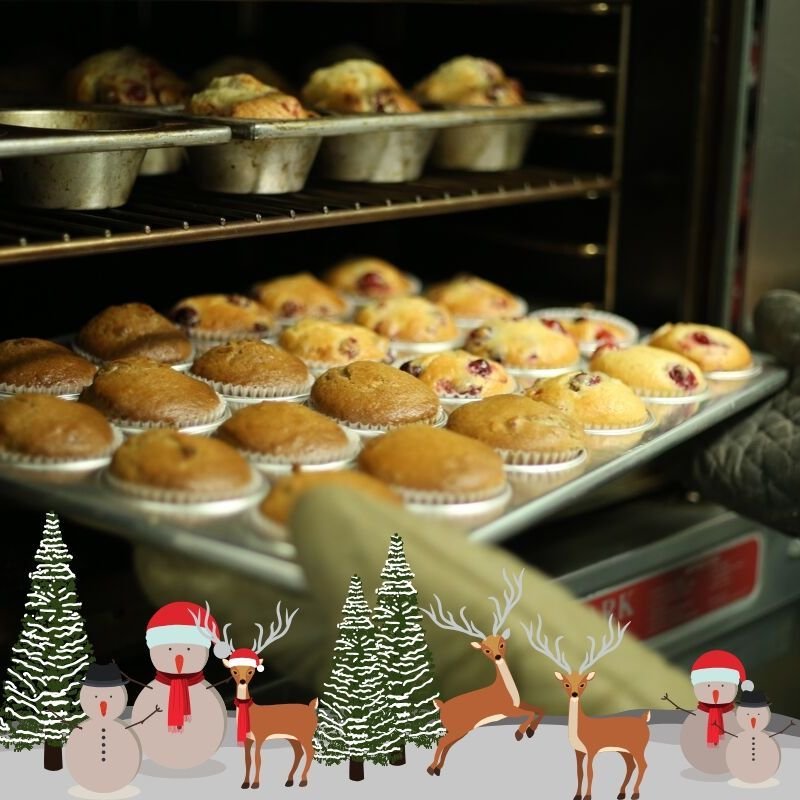 muffins coming out of oven with christmas cartoon