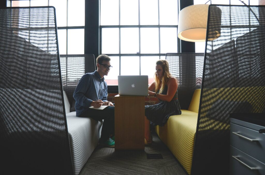 two people having meeting at table